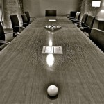 Empty conference table in corporate board room.